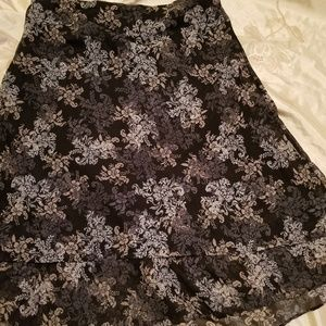 black maxi skirt with white and beige flowers